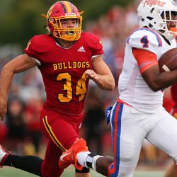 Batavia's Quinn Urwiler (34) chases down East. St. Louis' DaMonta Witherspoon (4).