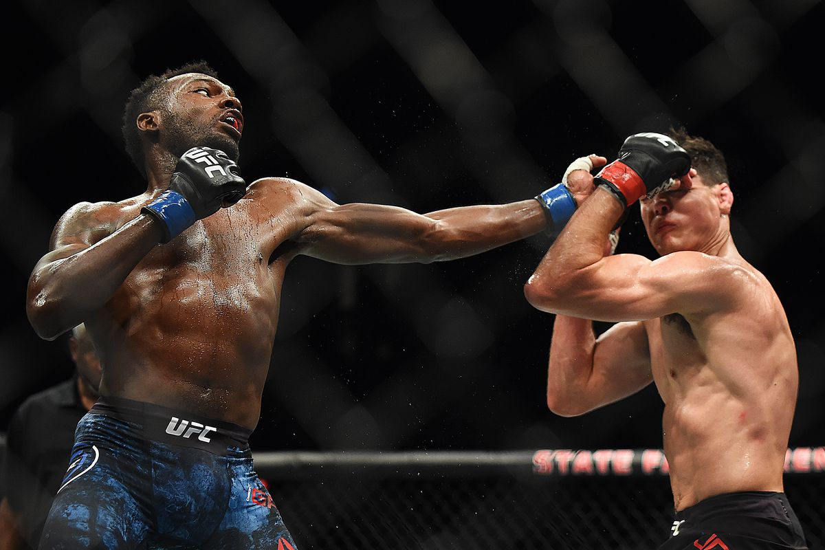 Dwight Grant punches Alan Jouban during the UFC 236 event at State Farm Arena on April 13, 2019 in Atlanta, Georgia.