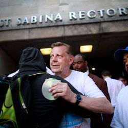 Rev. Pfleger greets attendees | Jim Young/Getty Images