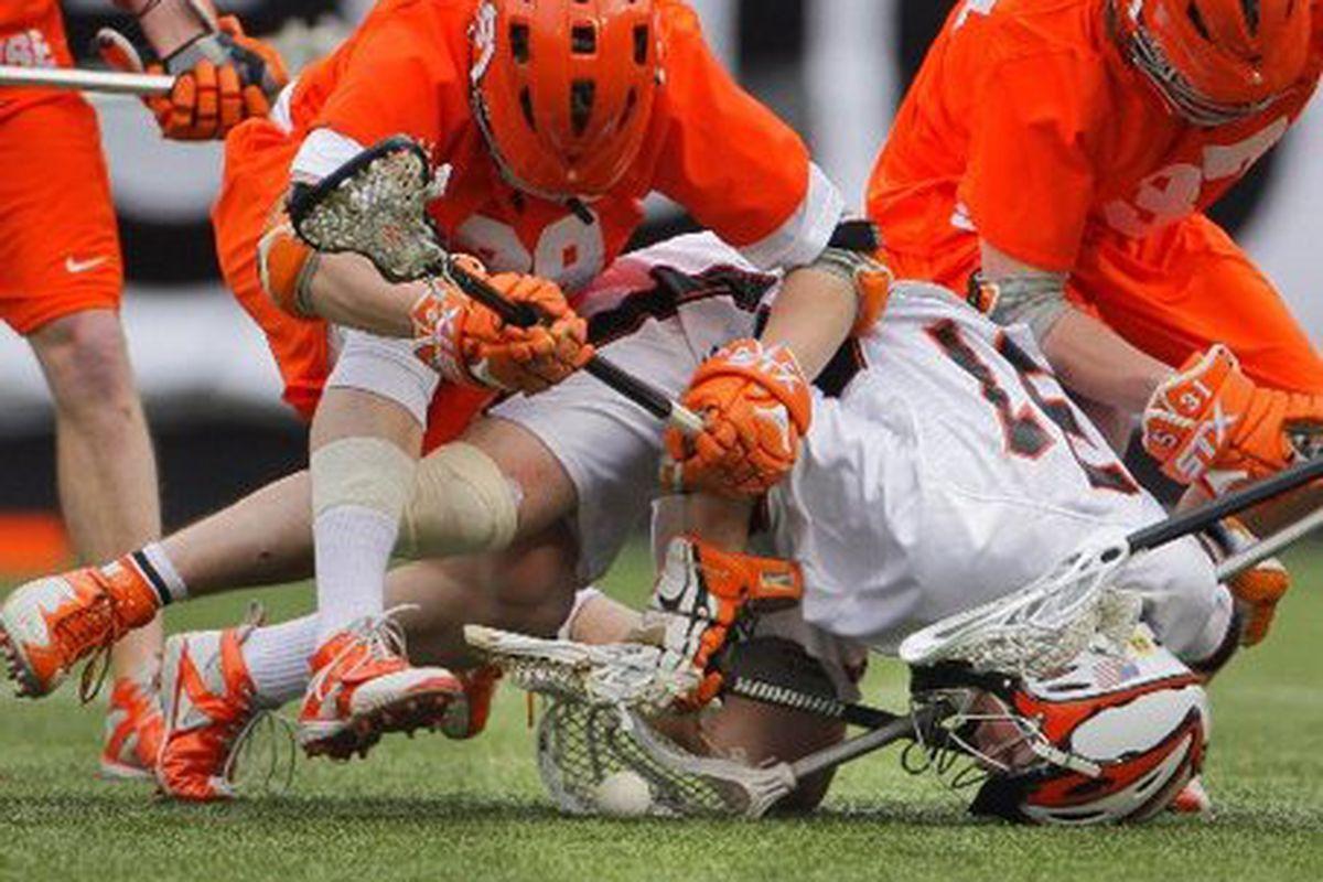 "Syracuse and Princeton, apparently recreating THE ACCUSED.  via <a href=""http://blog.nj.com/njsports_impact/2009/04/large_colijlax.jpg"">blog.nj.com</a>"