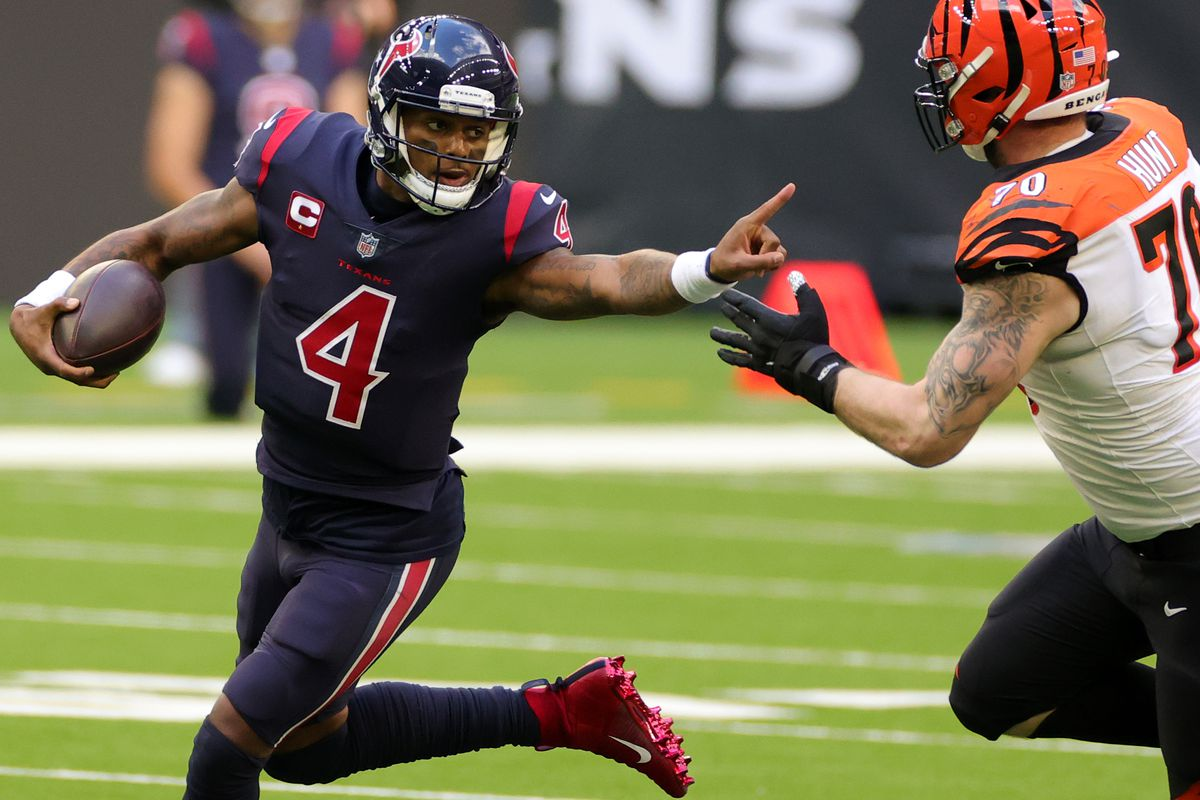 Quarterback Deshaun Watson #4 of the Houston Texans scrambles against defensive end Margus Hunt #70 of the Cincinnati Bengals during the fourth quarter of the game at NRG Stadium on December 27, 2020 in Houston, Texas.