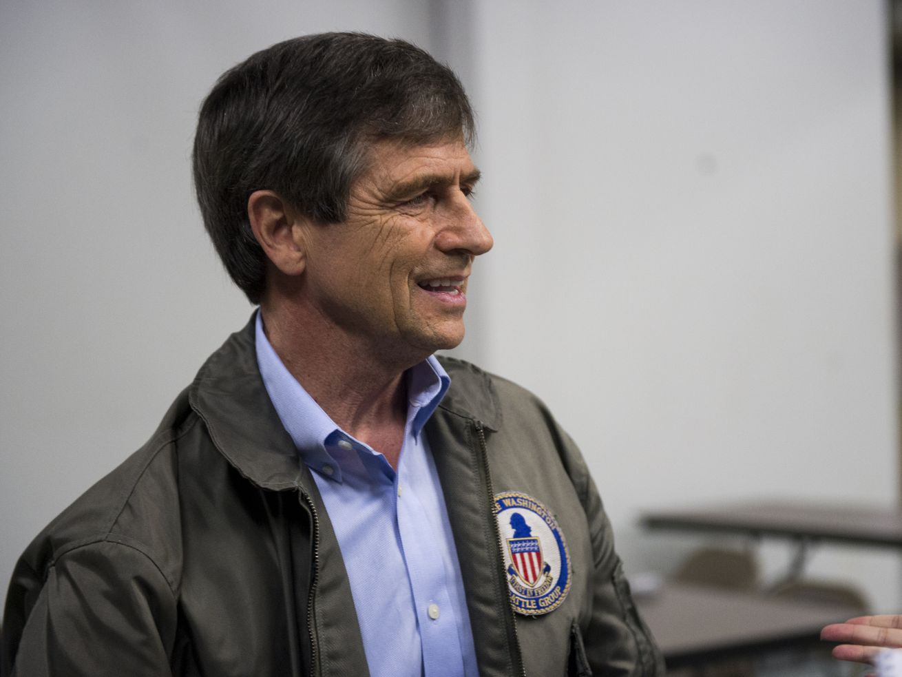 Candidate Joe Sestak wearing a jacket with a battle group patch.