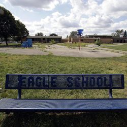 """A bench is shown outside the former Eagle Elementary School in West Bloomfield, Mich., Wednesday, Aug. 29, 2012. This affluent Detroit suburb with a diverse mix of religions and races and center of the region's Jewish community is the latest battleground over mosque construction, as some residents push back against a school district's decision to sell a vacant elementary school to an Islamic group. The Farmington Hills school district defends its agreement to sell Eagle Elementary School to a Muslim association and an administrator says opposition now can be classified as """"Islamophobia."""""""
