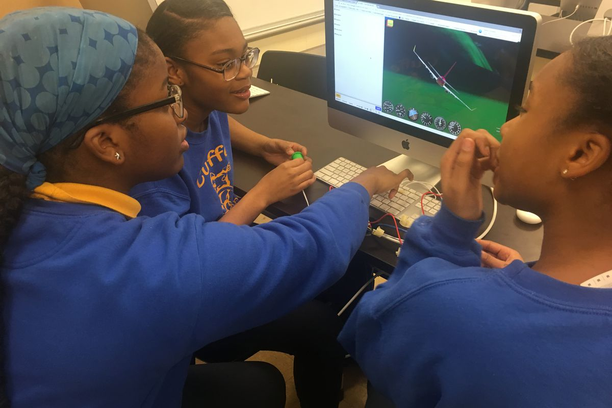 Vanessa Nwaige, center, works on a flight simulator at at Paul Cuffe Math-Science Technology Academy, an elementary school in Chicago on March 19, 2019. The school was one of 32 to receive funding from Chicago Public Schools to add high-demand programs.