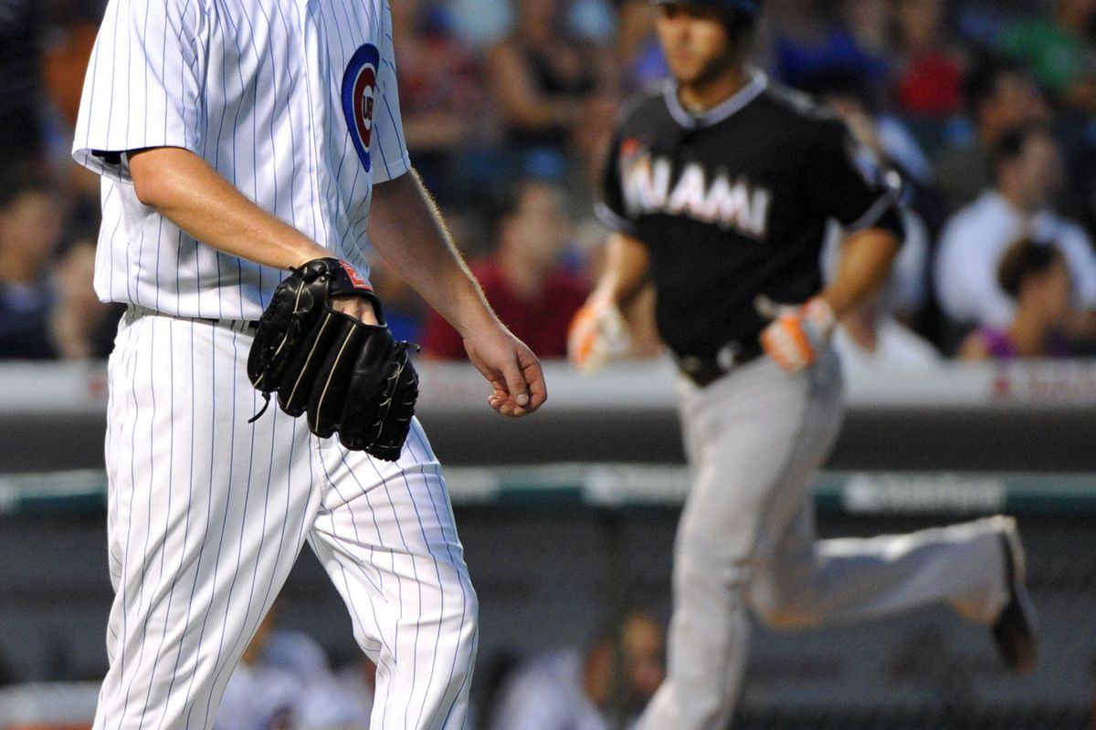 Chicago, IL, USA; Chicago Cubs starting pitcher Travis Wood reacts to giving up a grand slam home run against the Miami Marlins at Wrigley Field. Credit: Rob Grabowski-US PRESSWIRE