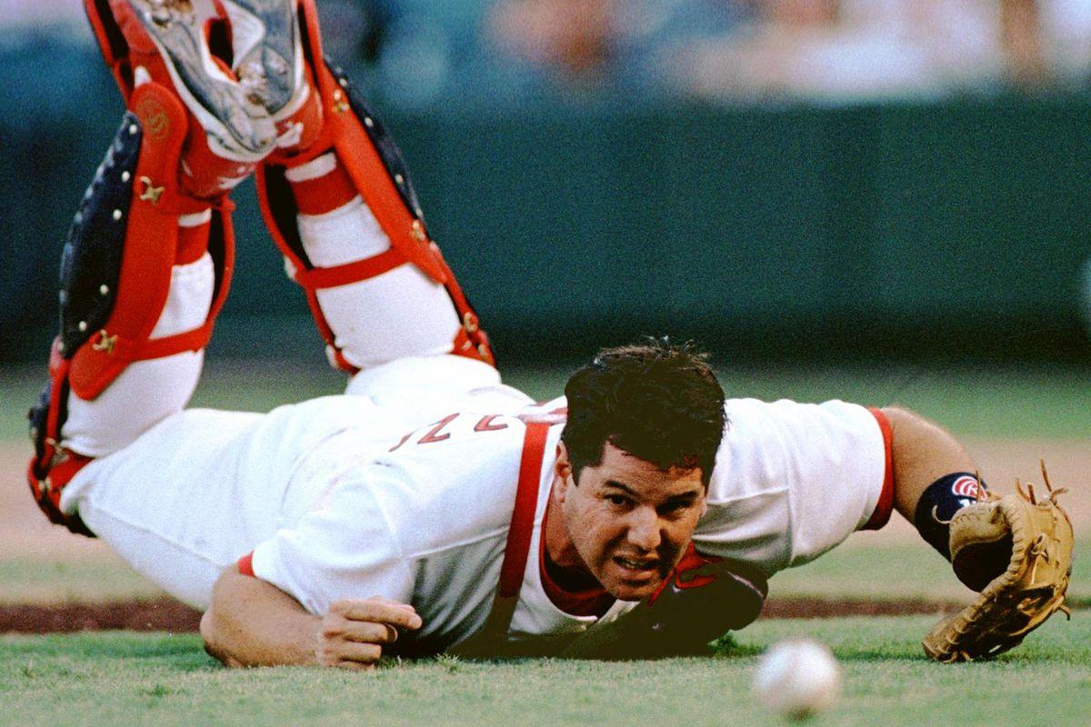 St. Louis Cardinal catcher Tom Pagnozzi dives but