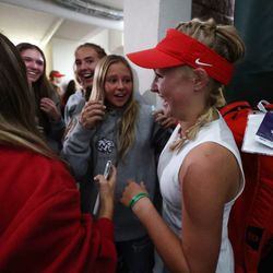 Woods Cross High School's Sage Bergeson celebrates with teammates after defeating Highland's Dylan Lolofie for the 5A tennis state championship at Salt Lake Tennis & Health Club on Saturday, Oct. 9, 2021.