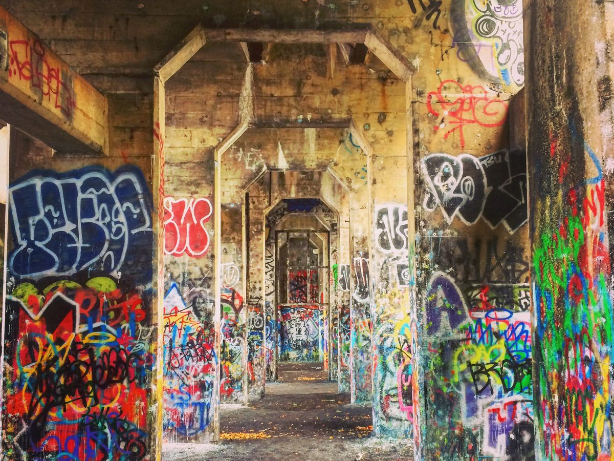 A pier on the Delaware River which is abandoned. It is covered in colorful graffiti.
