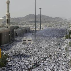 Muslim pilgrims pray outside Namira mosque in Arafat near the holy city of Mecca, Saudi Arabia, Thursday, Oct. 25, 2012. Saudi authorities say around 3.4 million pilgrims — some 1.7 million of them from abroad — have arrived in the holy cities of Mecca and Medina for this year's pilgrimage. (AP Photo/Hassan Ammar)