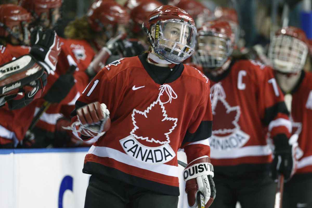 SALT LAKE CITY, UTAH - FEBRUARY 19: Defender Geraldine Heaney #91 of Canada celebrates with teammates during their game against Finland at the Salt Lake City Winter Olympic Games on February 19, 2002 at the E Center in Salt Lake City, Utah.