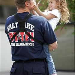 Utah Unified firefighter Steve Schaugaard plays with his daughter Hadley before he departed Wednesday to help with Hurricane Rita relief.