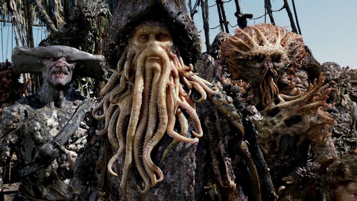 davy jones and his barnacled buddies stand on a pirate ship dock