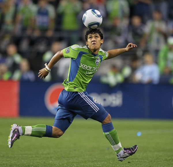 SEATTLE - AUGUST 08:  Fredy Montero #17 of the Seattle Sounders FC heads the ball against the Houston Dynamo on August 8 2010 at Qwest Field in Seattle Washington. The Sounders defeated the Dynamo 2-0. (Photo by Otto Greule Jr/Getty Images)