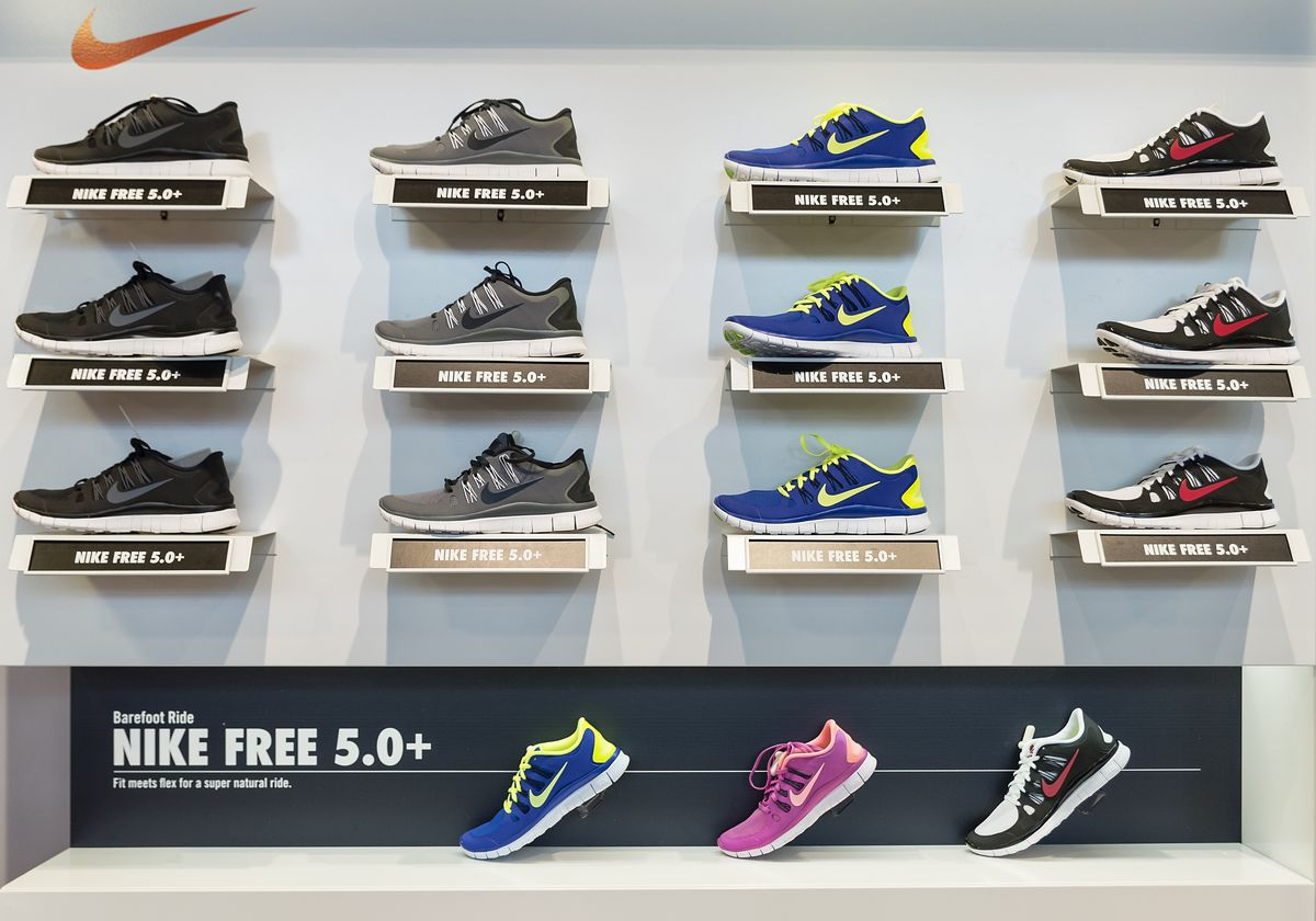 Colorful Nike Free running shoe display in a Nike store