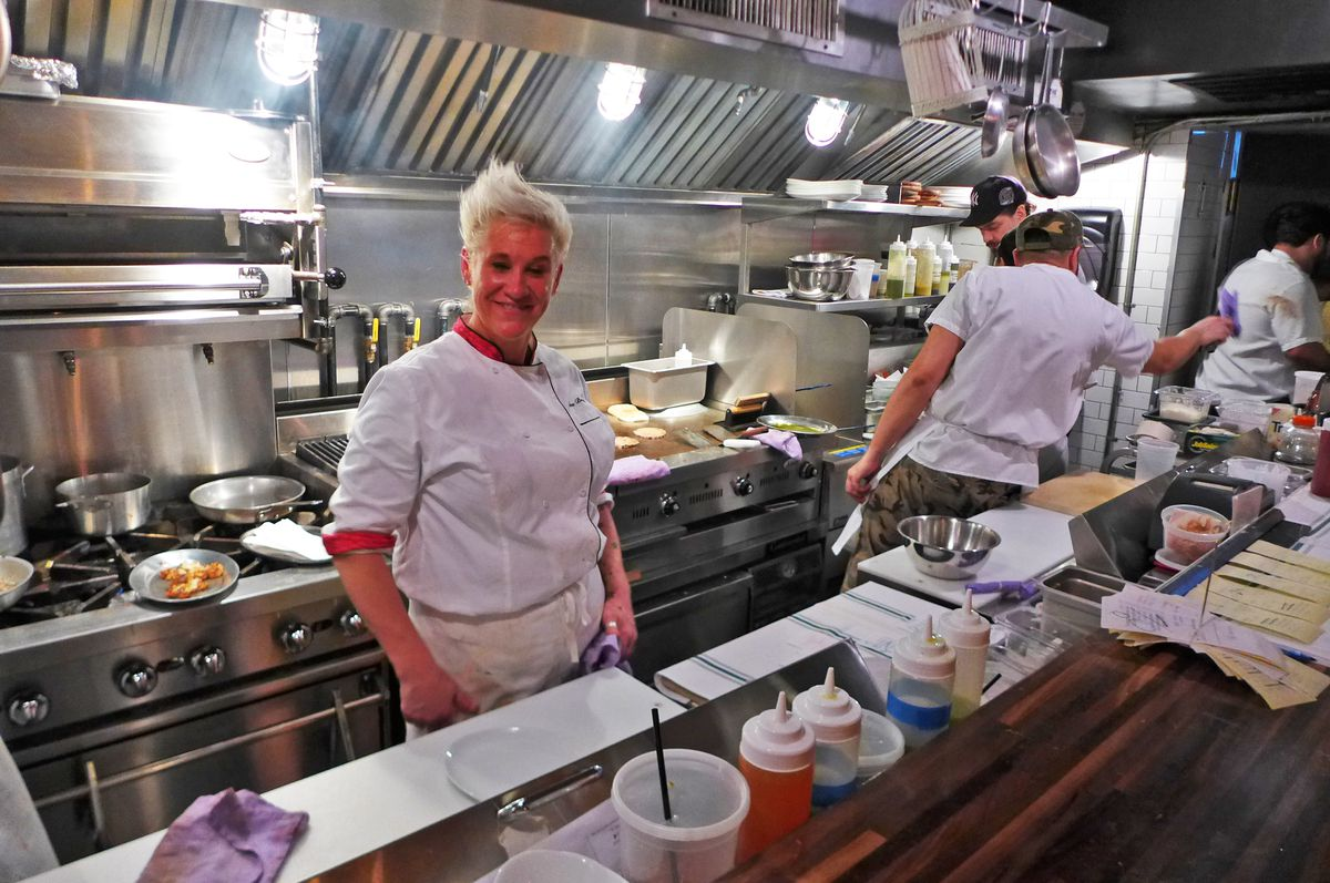 Chef Anne Burrell is in a bright kitchen.