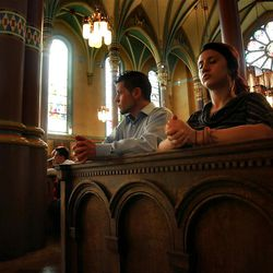 Byron Crosby sits in Easter Mass at the Cathedral of the Madeleine Sunday, April 8, 2012 in Salt Lake City with his daughter Brianna Howard.