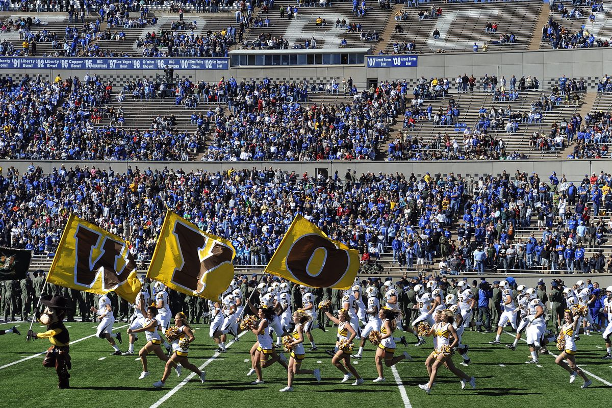 Wyoming takes the field at the start of the Air Force Falcons football game against the Wyoming Cowboys at the Air Force Academy in Colorado Springs, CO. (Craig F. Walker / The Denver Post)