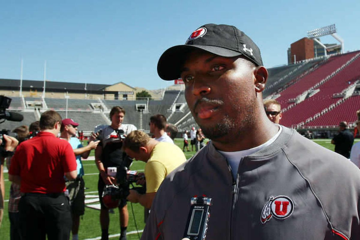 Co-offensive coordinator Brian Johnson is interviewed after the University of Utah football team scrimmages in Salt Lake City, Tuesday, Aug. 13, 2013.