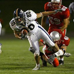 BYU's Toby Christensen makes a first down in final drive of the game Saturday night before UNM's Joe Selander brings him down.