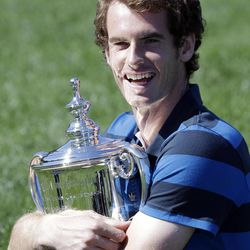 2012 U.S. Open tennis men's singles champion Andy Murray, of Britain, poses in Central Park on Tuesday, Sept. 11, 2012, in New York.