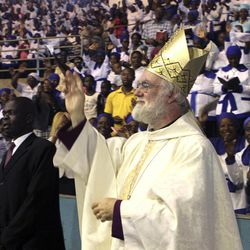 """FILE- Britain's Archbishop of Canterbury Rowan Williams greets worshippers to a religious service in Harare, Zimbabwe, in this file photo dated Sunday, Oct. 9, 2011. In an interview published Saturday Sept. 8, 2012, in Britain's Daily Telegraph newspaper, Williams said the Anglican Church is planning to give some of the global duties of the Archbishop of Canterbury to a """"presidential"""" figure so the archbishop can concentrate on leading the Church of England, and admitted he didn't do enough to prevent divisions in the Anglican church over homosexuality."""