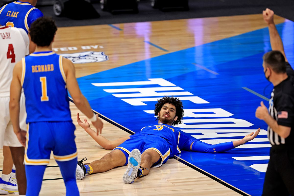 UCLA Bruins guard Johnny Juzang reacts to a call during the first half against the Alabama Crimson Tide in the Sweet Sixteen of the 2021 NCAA Tournament at Hinkle Fieldhouse.