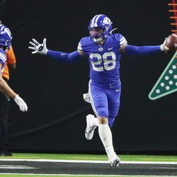Brigham Young Cougars defensive back Hayden Livingston (28) celebrates his interception during the Vegas Kickoff Classic in Las Vegas on Saturday, Sept. 4, 2021. BYU won 24-16.