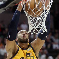 Utah Jazz center Rudy Gobert (27) dunks the ball during an NBA game against the San Antonio Spurs at Vivint Arena in Salt Lake City on Friday, Feb. 21, 2020.The Jazz lost 104-113.
