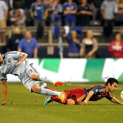KANSAS CITY, KS - APRIL 14:  Roger Espinoza #15 of Sporting Kansas City battles Tony Beltran #2 of Real Salt Lake for the ball during the Major League Soccer game on April 14, 2012 at Livestrong Sporting Park in Kansas City, Kansas.  (Photo by Jamie Squire/Getty Images)