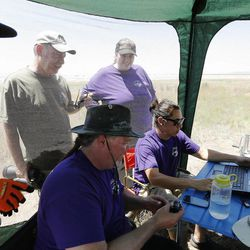 Researchers look over data retrieved from an aerostat used to study ozone at Ogden Bay Waterfowl Management Area near the Great Salt Lake Wednesday, June 17, 2015. The Utah Department of Environmental Quality's air quality scientists and researchers from Utah universities are deploying sensors this summer to detect smog-forming ozone.