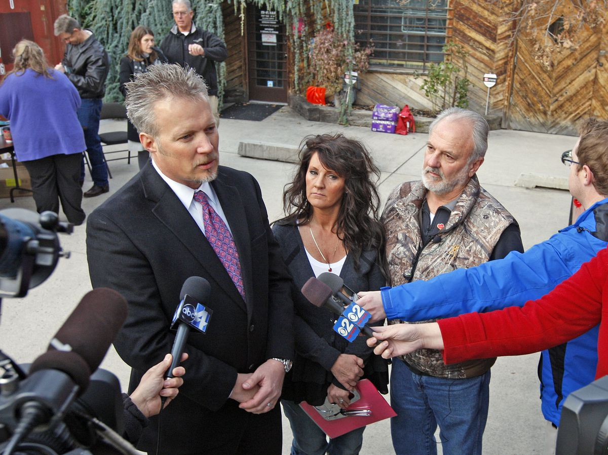 Greg Miller, Heidi Miller and Earl Black, left to right, at a press briefing in 2012 offering a $1000,000 reward for information leading to the conviction of Sherry Black's killer, as family and friends of Sherry Black gather at the bookstore on 3466 South 700 East where Sherry was murdered two years earlier.