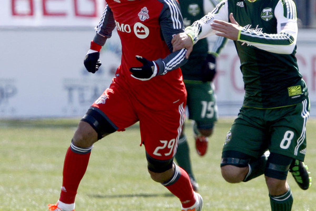 Reserve Captain Peter Lowry chases down Maicon Santos in the Portland Timbers' away match against Toronto FC earlier this year.