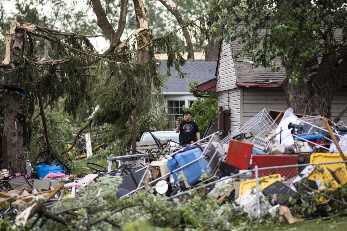 Residents survey the damage to several homes on Evergreen Lane near Janes Avenue on Monday, June 21, 2021 in Woodridge, after a tornado ripped through the western suburbs overnight.