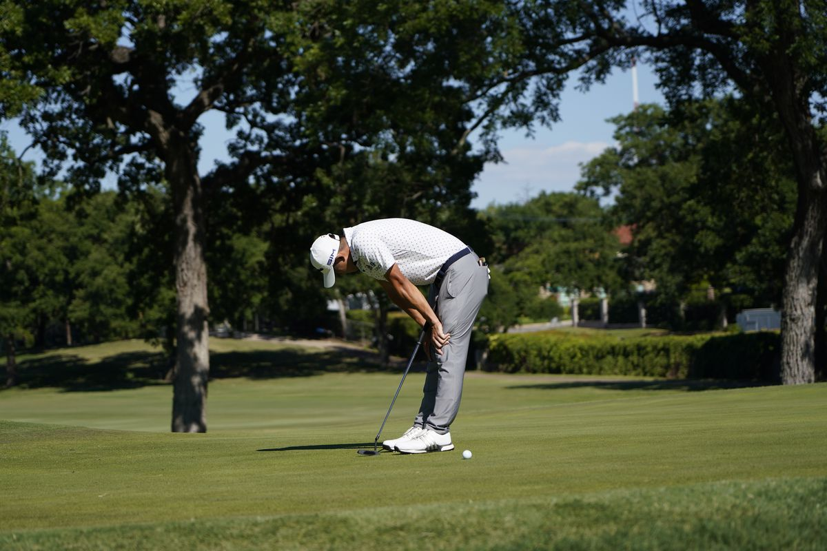 Coilin Morikawa misses a putt on the 17th green during a playoff round Sunday.