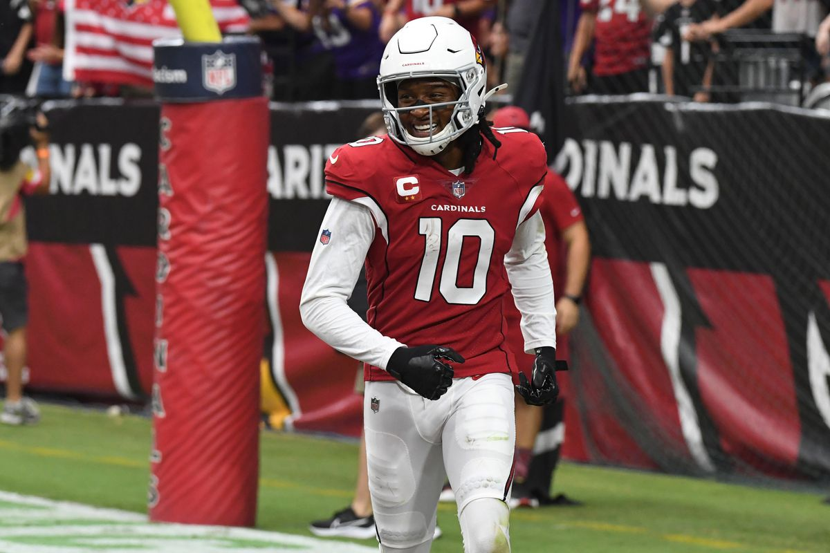 DeAndre Hopkins #10 of the Arizona Cardinals celebrates after catching a touchdown pass against the Minnesota Vikings at State Farm Stadium on September 19, 2021 in Glendale, Arizona.