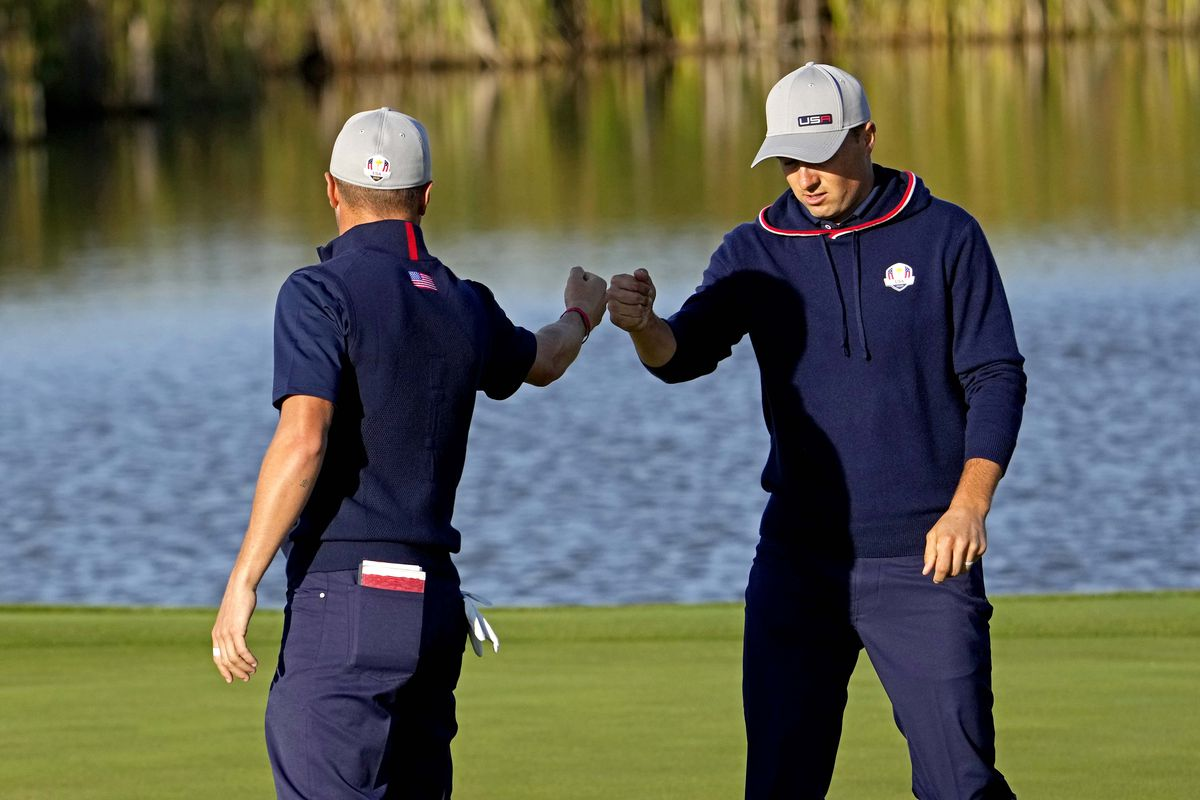 Team USA player Justin Thomas and Team USA player Jordan Spieth fist bump on the fifth green during day one foursome matches for the 43rd Ryder Cup golf competition at Whistling Straits.