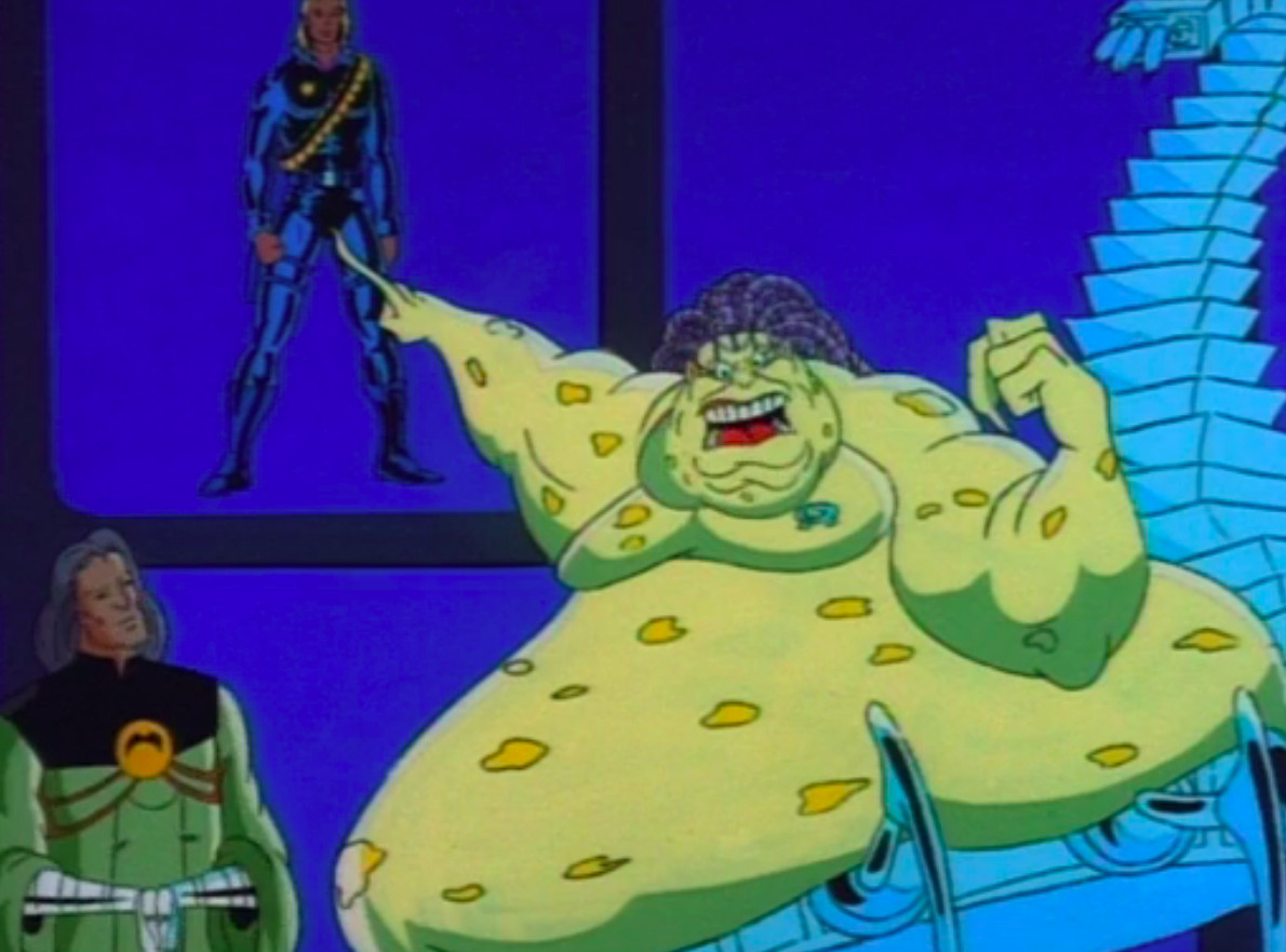 mojo in x-men the animated series pointing at a tv and yelling