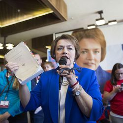"""State Sen. Margaret Dayton shows her """"No Child Left Behind"""" bill while answering a question from supporters while campaigning for the vote of Republican delegates at Timpview High School in Provo on Saturday, June 17, 2017."""