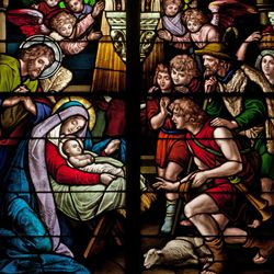 This stained glass window shares the Nativity scene.