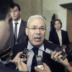 """Leader of the opposition Syrian National Council, Burhan Ghalioun, talks to reporters after his meeting with Egyptian Foreign Minister Mohamed Kamel Amr, unseen, in Cairo, Egypt, Monday, April 23, 2012. Minister Mohammed Amr stressed to the opposition that they must unify their ranks under one group with one vision presented to the world about the future of Syria. """"This in itself will send a reassuring message to all regional and international parties about the possibility of starting a dialogue with the opposition,"""" he said. (AP Photo/Amr Nabil)"""
