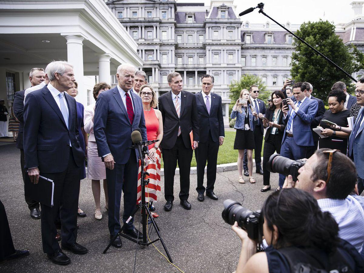 President Biden speaks with reporters after meeting with twenty one Republican and Democratic Senators on his infrastructure plan on June 24.
