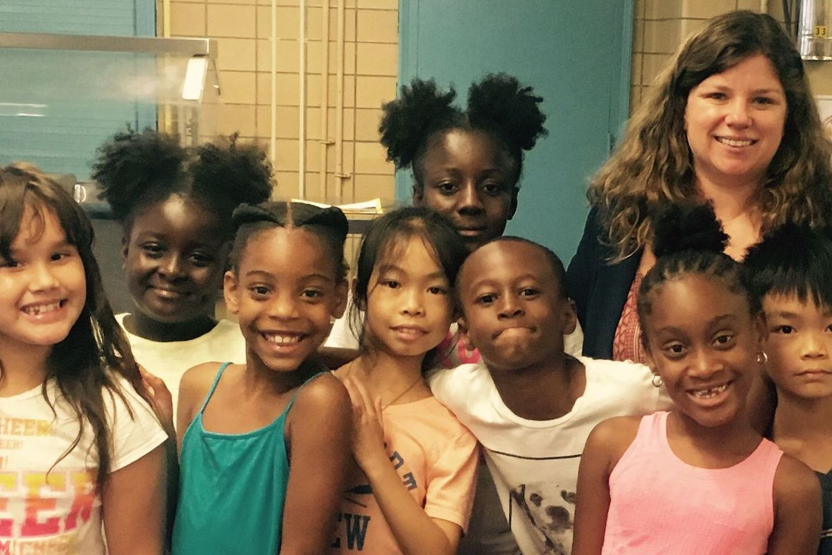 """P.S. 191 Principal Lauren Keville with some of her students. The school was removed from the state's list of """"persistently dangerous"""" schools."""