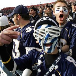 BYU fan Dustin Mathews makes his voice heard at the beginning of the matchup against the University of Utah at LaVell Edwards Stadium in Provo Saturday. BYU won in overtime, 26-23.