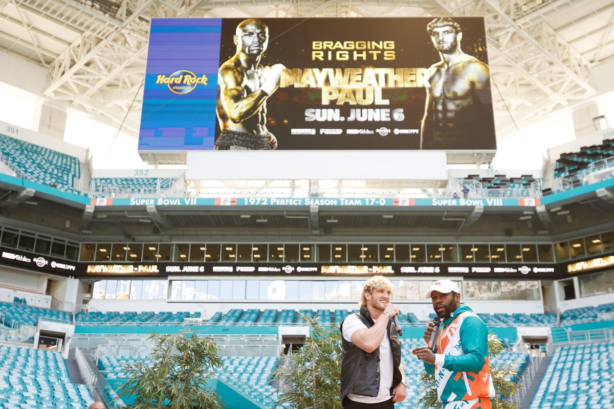 Floyd Mayweather and Logan Paul take part in media availability for their June 6 fight at Hard Rock Stadium on May 06, 2021 in Miami Gardens, Florida.