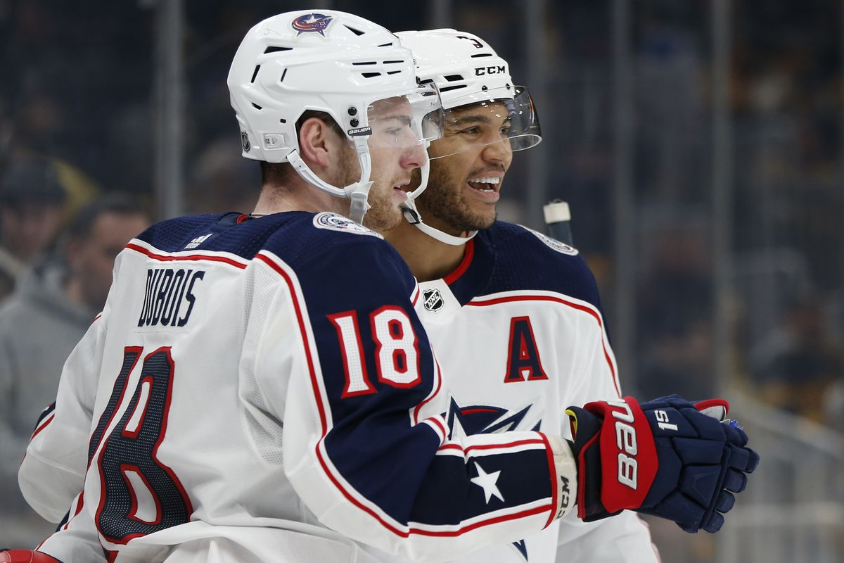 Columbus Blue Jackets center Pierre-Luc Dubois celebrates with defenseman Seth Jones after scoring the game winning goal during the overtime period against the Boston Bruins at TD Garden.