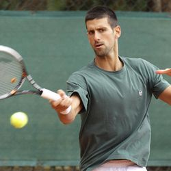 Novak Djokovic of Serbia plays a return  during a training session of the Monte Carlo Tennis Masters tournament in Monaco, Sunday, April 15, 2012.