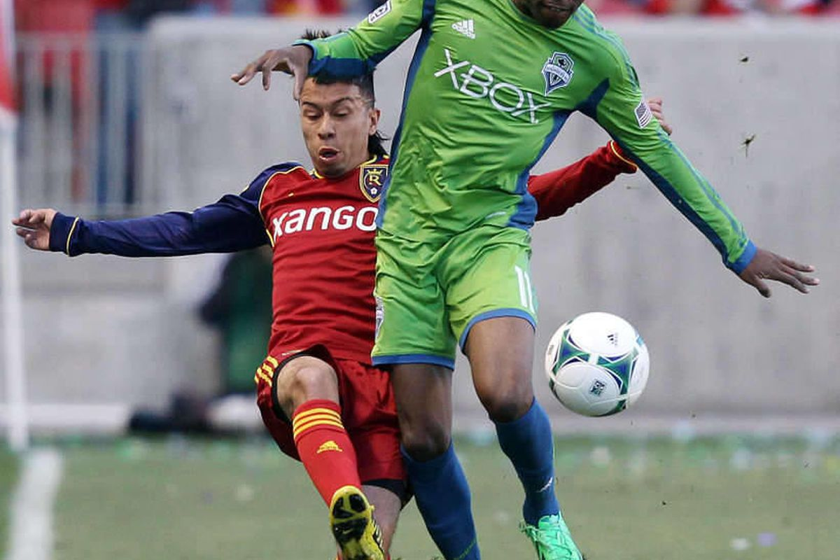Real Salt Lake midfielder Sebastian Velasquez (26) competes with Seattle Sounders FC midfielder Steve Zakuani (11) during MLS action in Sandy  Saturday, March 30, 2013.