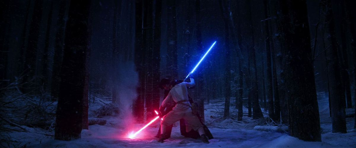 Rey (Daisy Ridley) and Kylo Ren (Adam Driver) duel in Star Wars: The Force Awakens.
