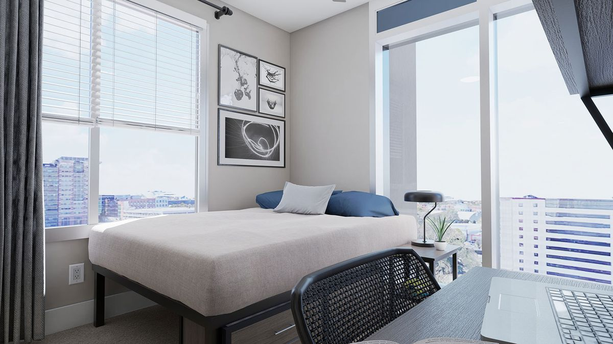 A bedroom offers sprawling skyline views.