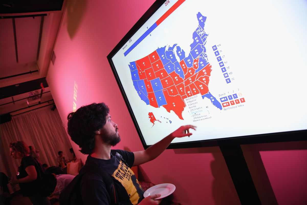 823f20c0383 A person experiments with an electoral map displayed at a Full Frontal With  Samantha Bee press junket on September 5